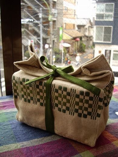 Love this sack as gift wrap. Monk's Belt is a weaving structure I might play with for my summer collection.