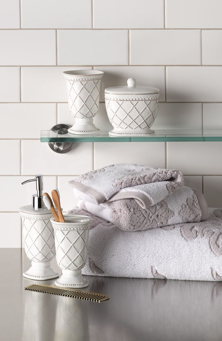 Decorating tip: Use all-white in a bathroom to brighten a room and make it feel bigger. White subway tiles as a backsplash are chic and classic. Add white towels, toothbrush holder, etc. for decorative pieces.