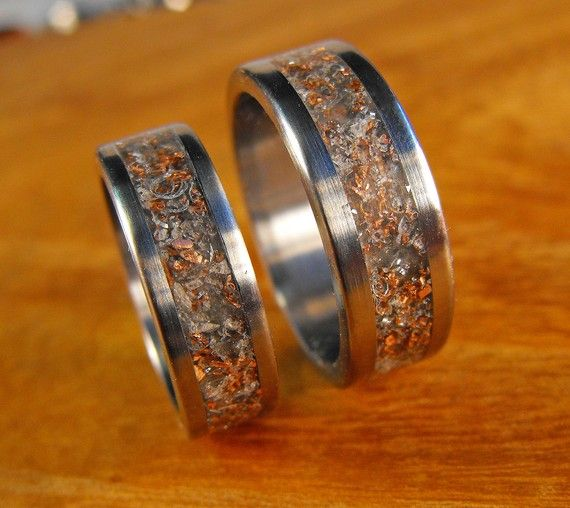 This handmade titanium ring set is simply beautiful. The rings in this his and hers ring set are inlaid with our very own junk inlay mix. We use leftover bits from making our rings to make this unique inlay- titanium, aluminum, copper and rose quartz are shown. We love the unique look of