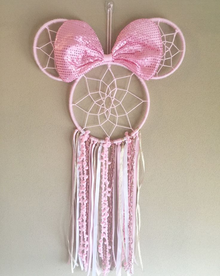 Sparkling Pink and Gold Minnie Mouse Dreamcatcher Made with ribbon, trims, yarns, and wood Large size Dreamcatcher Perfect for: Nurseries, birthdays, parties, photo shoots, home decor, or gifts Handmade in NJ