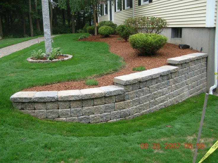 Retaining wall front yard pinterest for Rock and stone landscaping
