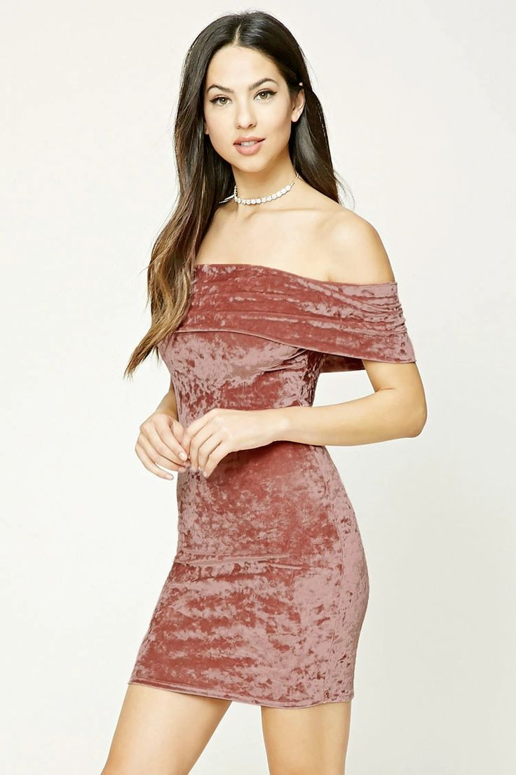A knit crushed velvet mini dress featuring a fold-over off-the-shoulder neckline, short sleeves, and a bodycon silhouette.