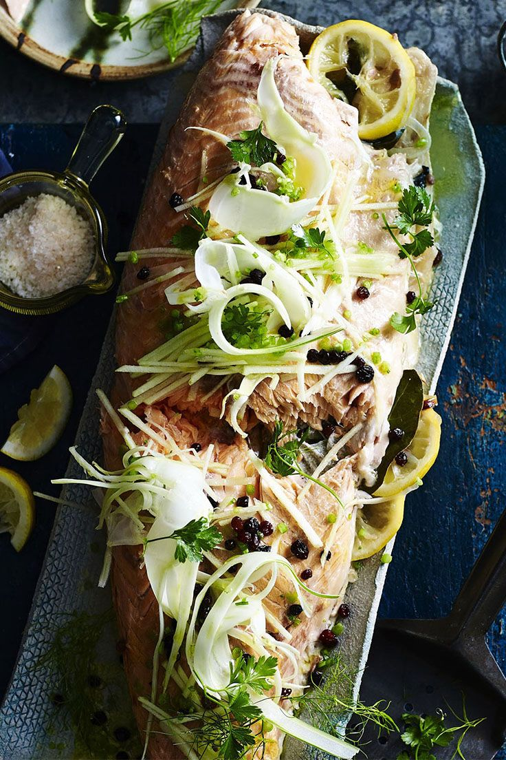 Serve up this gorgeous whole baked salmon for Christmas dinner for a memorable meal that's sure to please. Topped with a fennel and apple salad, this is one festive feast you'll love. Recipe by the Australian Women's Weekly.