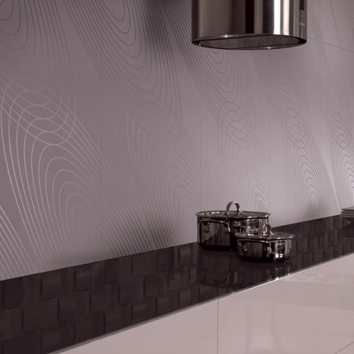 A modern kitchen featuring Porcel-Thin PARIS steel grey twin circle patterned porcelain tiles.  #patterned #kitchen #tiles