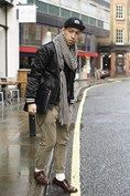 """John Jarrett, stylist  """"My hat and outer jacket are both by Brooklyn Circus. I'm wearing them over a Levi's vintage inner jacket with a Molly scarf, Uniqlo shirt, All Saints trousers and Oliver Sweeney shoes."""""""