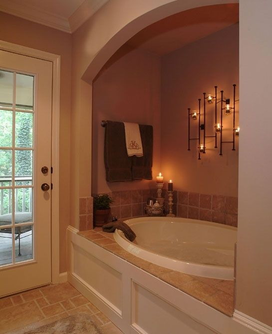 Love how the tub is set back in to the wall to create more of a cozy feel.  Also like having a towel bar close by and fun lighting in this space.