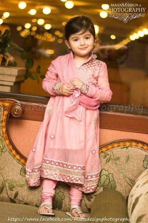 cute girl in baby pink Pakistani frock