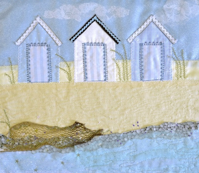 Beach Hut - limited edition print of three blue and white beach huts by the seaside.
