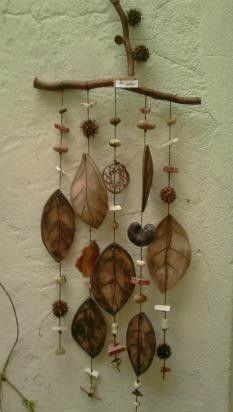 Llamador de ángeles hojas color natural. Precio $ 85.