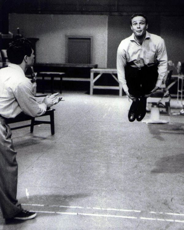 Marlon Brando in rehearsals for his film version of Guys and Dolls, 1955. Love his expression here. While Guys and Dolls is still one of my favorite stage musicals, this film was, sadly, not the best -- although Marlon did make an effective Sky Masterson.