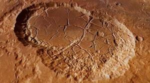 Sigli y Shambe    La sonda Marss Express de la Agencia Espacial Europea (ESA) ha tomado imágenes de dos cráteres conectados entre ellos, situados en la región marciana de los Valles de Landon, y en los que creen que pudo existir agua en estado líquido. + info: http://www.ecoapuntes.com.ar/2012/08/la-esa-difunde-imagenes-de-crateres-marcianos-en-los-que-pudo-existir-agua/