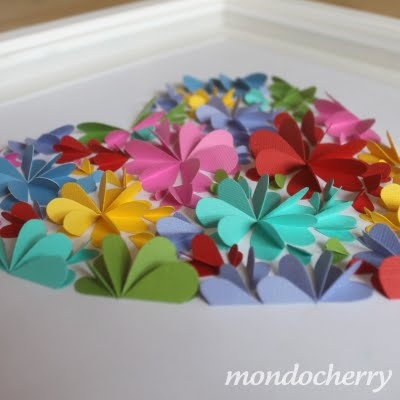 These 3d paper artworks (from the Aussie blog Mondocherry) are made from paper hearts folded in half. Beautiful!