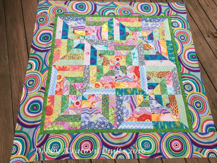 """Rainbow Strips, a workshop from several years ago, still works today with KF 2-1/2"""" strips. Love that Target border print!"""