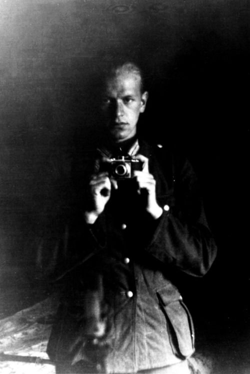 """bag-of-dirt:  Self-portrait of a German Wehrmacht soldier;a 1940s """"selfie"""", utilizing a camera and mirror. Date and location unkown, circa 1940-1942."""