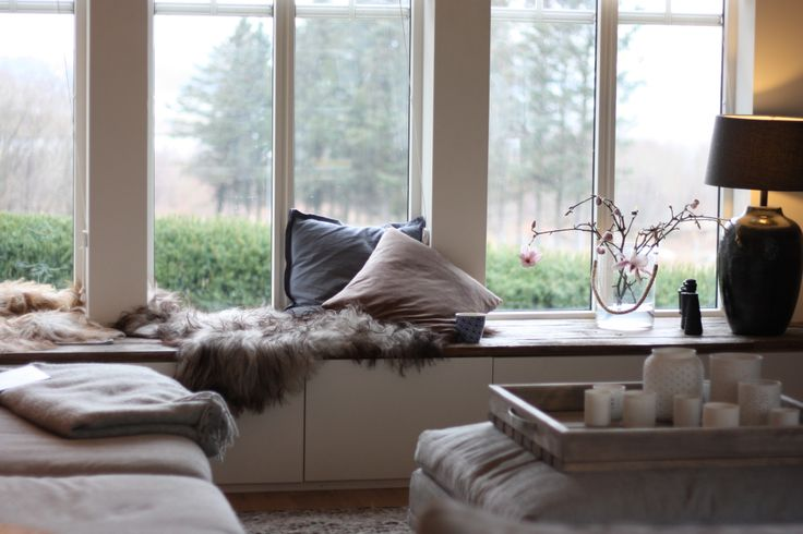 Window seat made from Ikea Bestå storage combination and vintage barn boards
