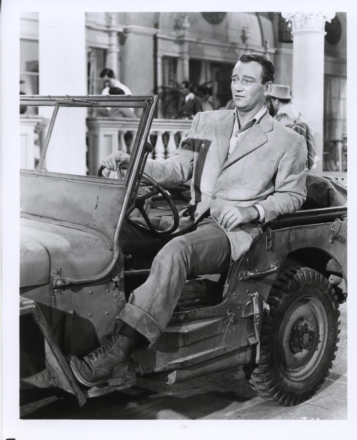 John Wayne and his jeep.  He can't quite fit...