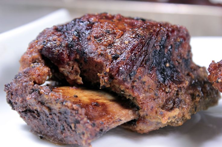 This recipe for wine braised smoked beef short ribs will walk you through the process of smoking them low and then braising them with wine to make them tender.