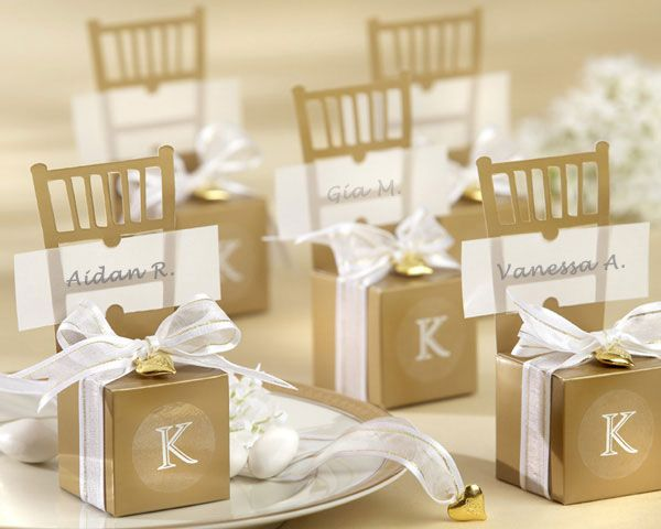 Miniature gold chair favour boxes with gold heart charm and ribbon