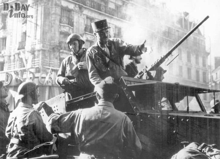 French General Jacques-Philippe Leclerc (on top of the armored vehicle) during the liberation of Paris.