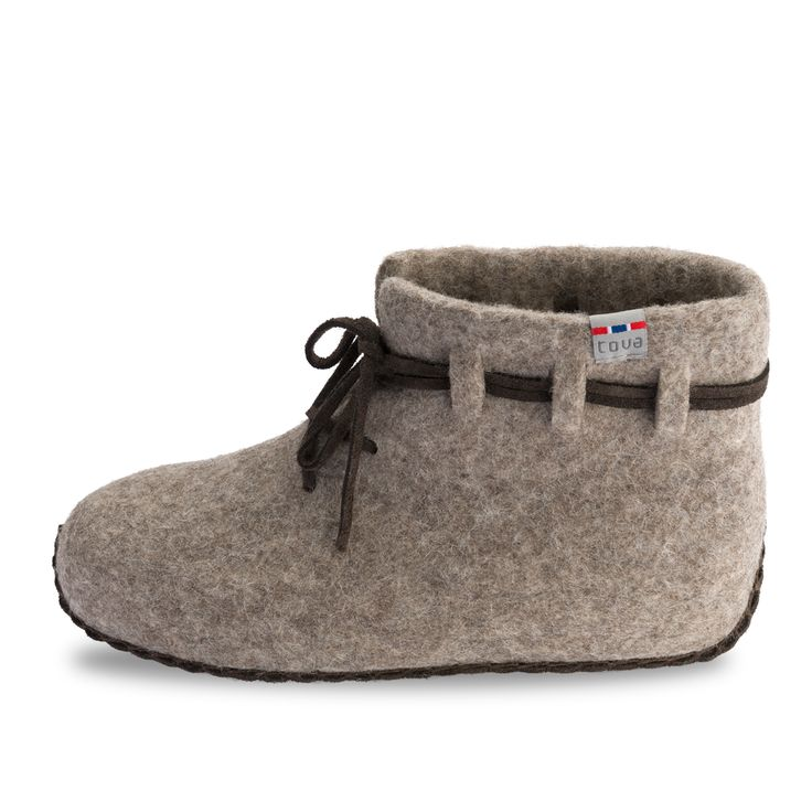 TOVA JORVIK WOOL SLIPPER. Based on a medieval Viking shoe. Approved by archaeologists at the Viking Museum in Oslo, Norway. 100% natural-colored Merino wool with a hand-stitched suede sole. A Viking shoe made of goatskin was found during excavations in medieval Jorvik (modern-day York, England).  TOVA has re-created this shoe in cozy wool to make a Viking slipper. Comes in a cotton bag with Viking print. Norwegian Design. tova.no . birchcountrystore.com