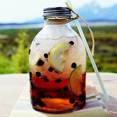 Easy-to-make flavored ginger ale with blueberries, lemon, lime and ginger via Better Homes & Gardens