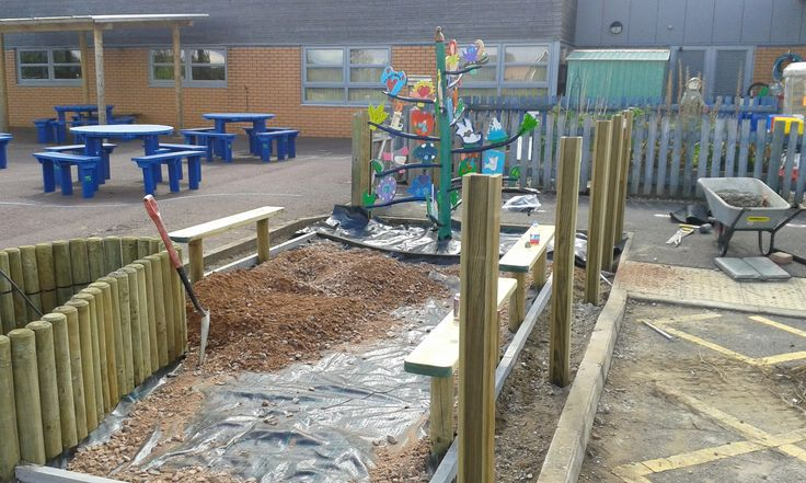 Values tree at far end, raised bed ready for water feature and benches for the children to sit on to enjoy the area.