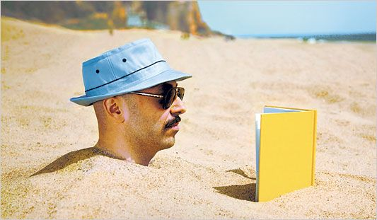 Reading a book from Dymocks at the beach
