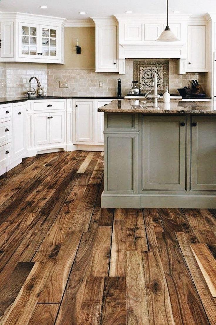 Natural hard wood floors - white cabinets - accented sea foam island ◇◇◇