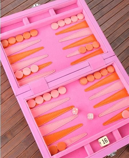 Backgammon is one of my favorite board games and although this might not be everyone's cup of tea, I think it's quite cool to see such exotic and vivid color themes in a backgammon set such as the one shown in this photo.