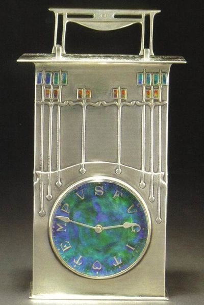 Archibald Knox, Art Nouveau designer of Scottish descent. - Wonderful pin.  This looks like a transition piece between McIntosh School Post Modern and Art Deco.  Fantastic Clock.