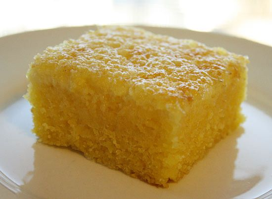 A quick and easy Brazilian cornmeal cake recipe.  This recipe is from my cousin Kathy from Food For Every Season. Her grandma's recipe from Brazil which used coffee cups for measurements so Kat had to translate this recipe into real measurements, and I'm glad she did. Everything goes in the blender, now that's my kind of baking!   I love this cake. Every time I'm with her I ask her to make it for me. I even asked her to make this for my birthday. It's similar in texture to cornbread only…