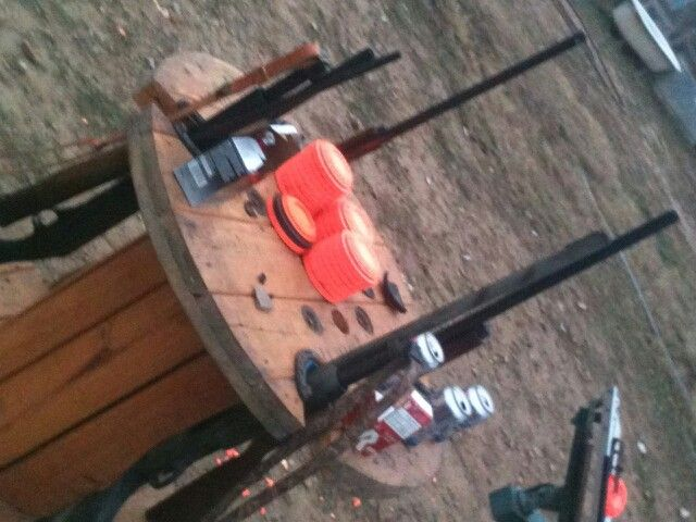 My husband took a wire spool and turned it into a gun table for the skeet range.