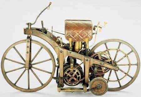 """World's First Motorcycle (1885) – Daimler's riding car    The First Motorcycle was designed and built by the German inventors Gottlieb Daimler and Wilhelm Maybach in Bad Cannstatt (Stuttgart) in 1885. It was essentially a motorised bicycle, although the inventors called their invention the Reitwagen (""""riding car""""). It was also the first petroleum-powered vehicle."""