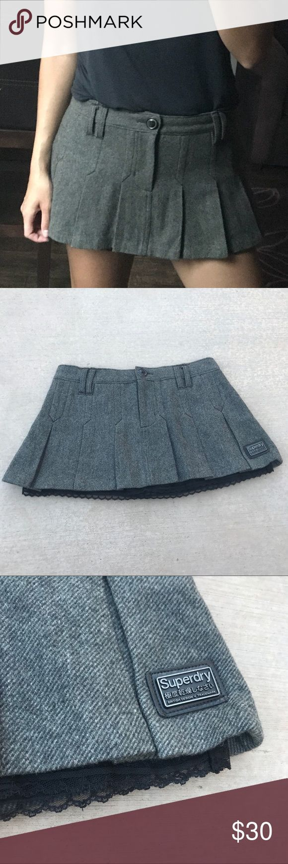 "Super Dry Pleated Mini Skirt • 71% wool / 15% polyester / 8% acrylic / 6% nylon • Pleated • Lined with lace edge satin that pokes out under outer layer • Button and hidden zipper closure • Length 11"" • Flat waist measurement 15"" Super Dry Skirts Mini"