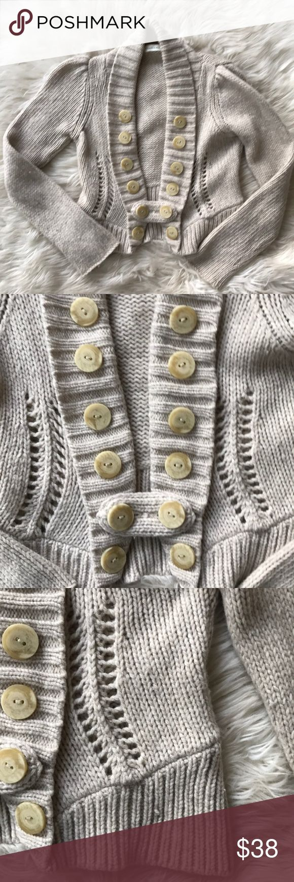 """Anthropologie Charlie & Robin Parade Route Knit Anthropologie Charlie & Robin Parade Route Cardigan Sweater. Excellent used condition. Some very minor piling. Oatmeal color, 100% wool. Lovely knitted features. Very cozy. Wooden buttons on each side and two button tab closure. Thus tab can be flipped and worn with the fabric facing out for contrast. Pit to pit 15"""", length 19"""". Anthropologie Sweaters Cardigans"""