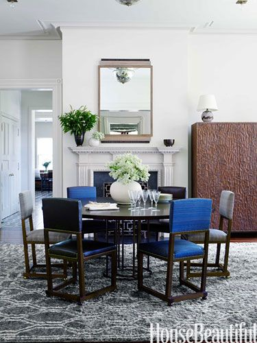 In this Rhode Island dining room, designer Juniper Tedhams found a pair of 1920s Swedish chairs in their original gray horsehair and had four copies made, covering one pair in Palma leather from Jasper and the other in Christopher Hyland's blue Paso horsehair.
