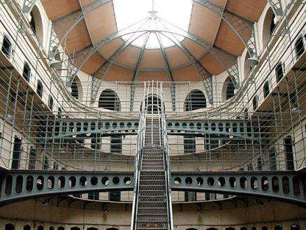 Interior of prison atrium, steel stairs and walkways, roof light