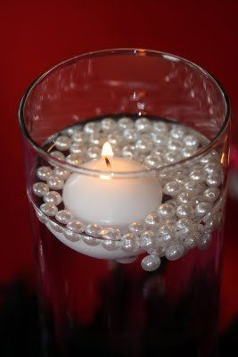 Candle & Pearls -- looks pretty and not pricey at all. I'd add another color of pearls with the white ones... Allan's idea he likes this