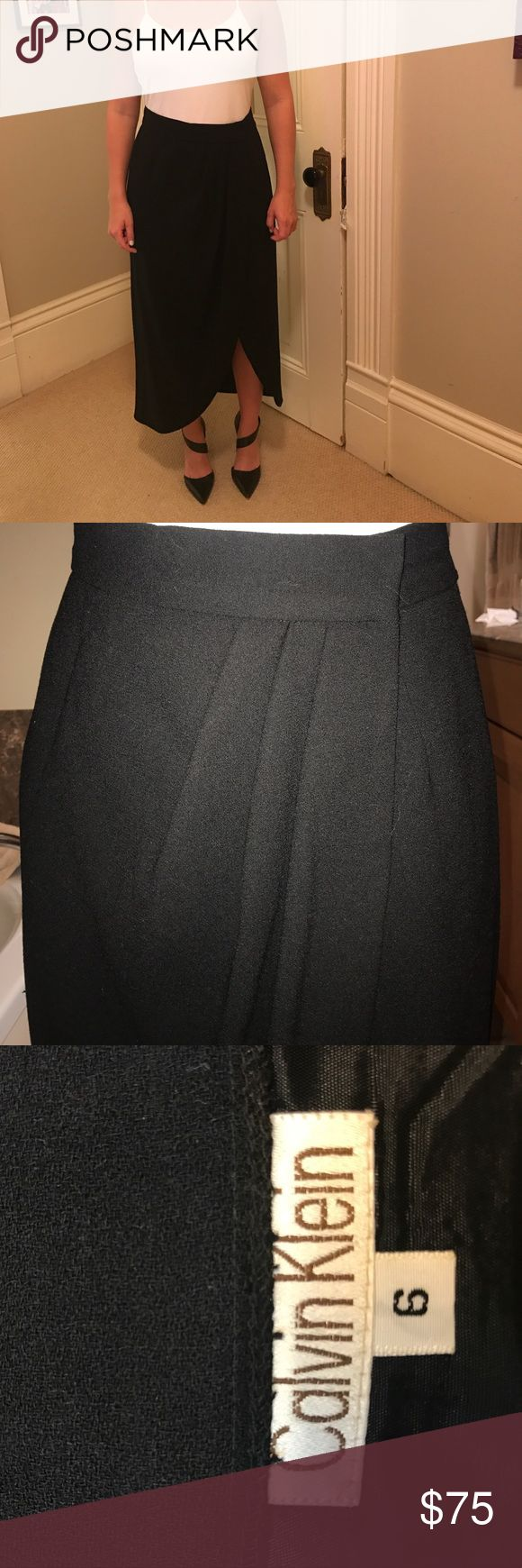 Calvin Klein pleated tulip long skirt. Fits more like a size 4. Beautiful black wool, fully lined. Calvin Klein Skirts Maxi
