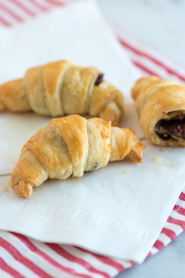 Sinfully Easy Chocolate Croissant Recipe - puff pastry + chocolate chips + egg = chocolate croissants