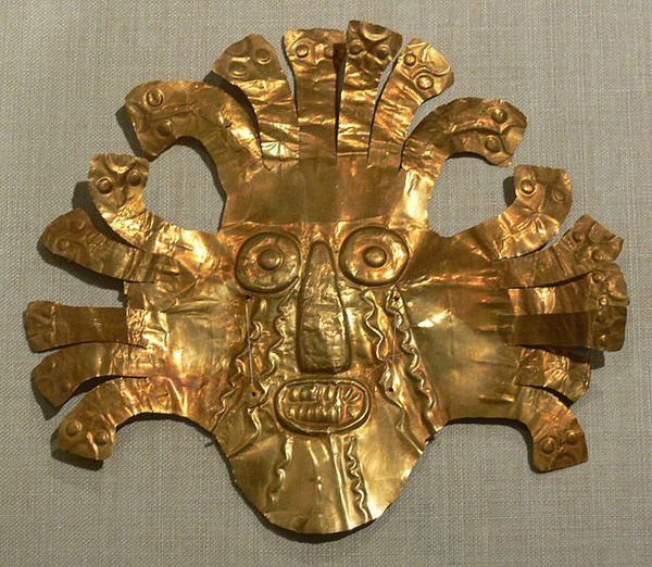 A beaten gold mask from the Nazca civilization of Peru, dating from 200 BCE-500 CE. The mask may represent a shaman in transformational pose, a common motif in Nazca art. An alternative interpretation is that it represents the weeping sun deity common to several ancient Andean cultures.