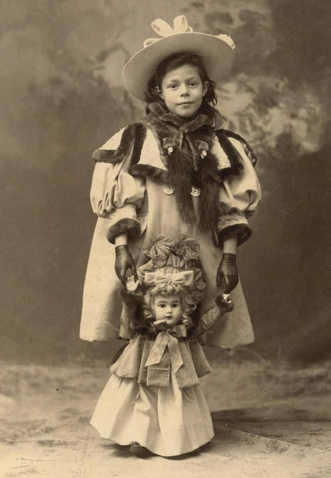 Child with a doll dressed similar to her, 1894-97.