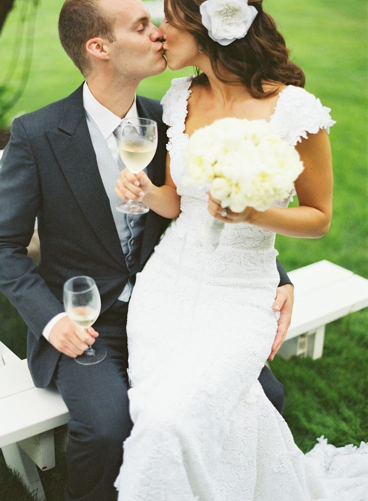 wedding toast...I adore her hairstyle and flower hair piece vs. a veil!