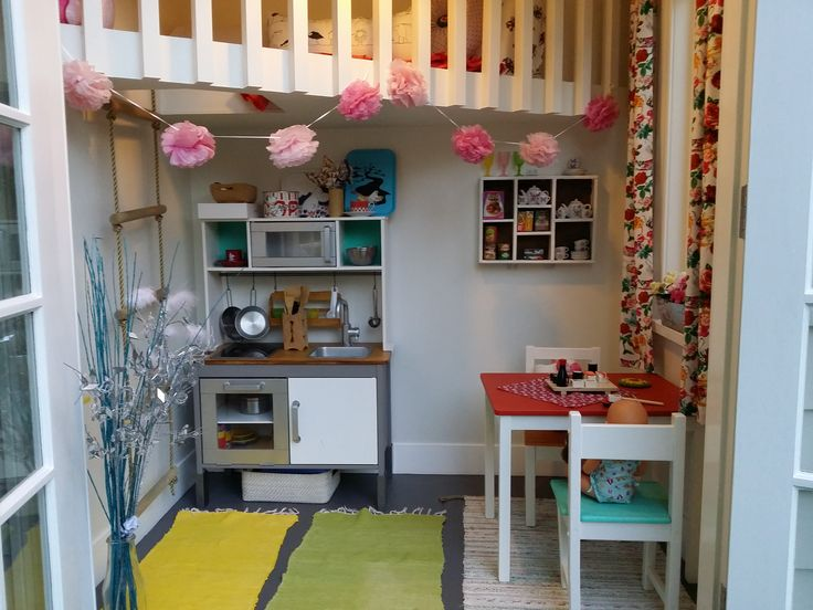 Cubby house interior with vintage shelving and upcycled Ikea play kitchen