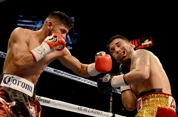 LAS VEGAS, NV- DECEMBER 13: Abner Mares (L) hits Jose Ramirez during their super featherweight fight at the MGM Grand Garden Arena on December 13, 2014 in Las Vegas, Nevada. (Photo by Donald Miralle/Getty Images)