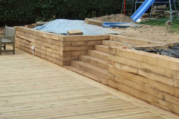 Nigel Sussex retaining wall project with railway sleepers and decking Photo 5a.jpg (904×605)