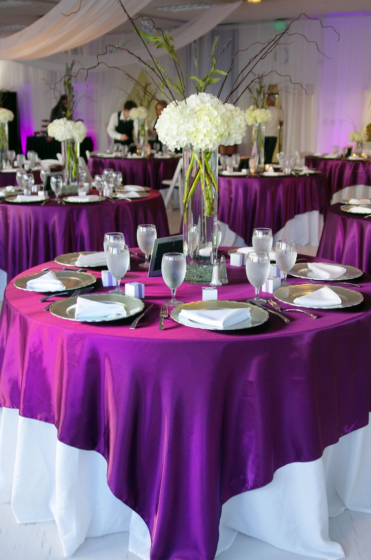 White tablecloth with purple overlay, one of my options. Use our magenta violet satin overlays and white tablecloths for this gorgeous look. www.cvlinens.com