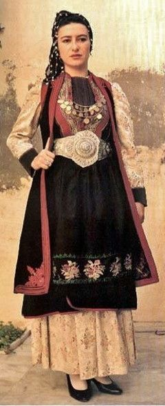 Traditional festive costume from Konitsa, (Epirus, northern Greece). Urban dress, early 20th century style.
