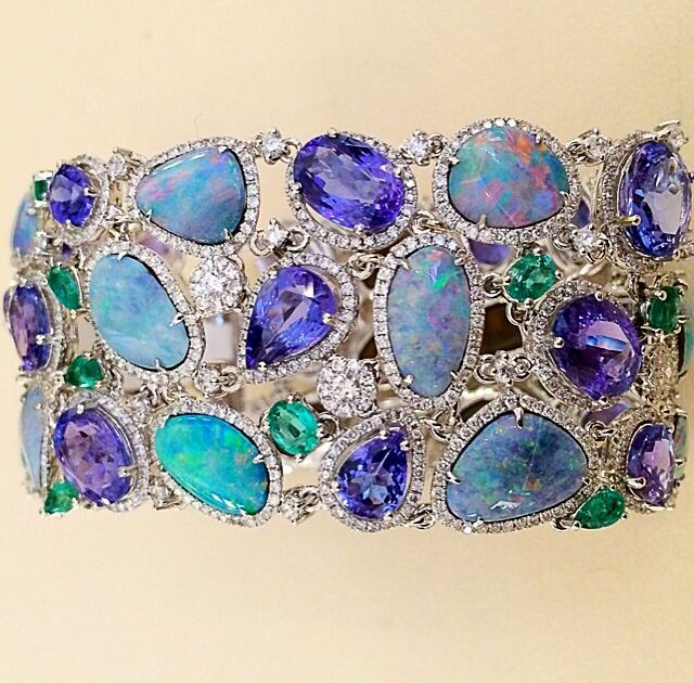 Cellini 's Opal Bracelet accented with Tanzanite , emeralds , and Diamonds on white gold