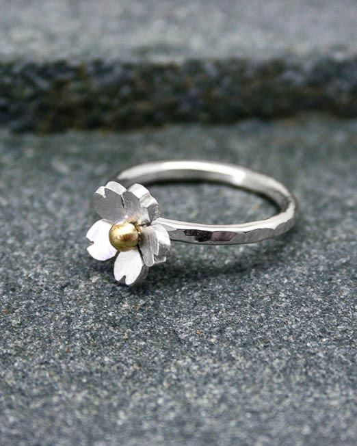 Sweet and simple daisy ring, this lovely ring is a must for everybody's jewellery box. Suitable for all occasions. The daisy has been hand saw pierced then lightly domed and completed with a brass bead and a lightly brushed finish. The band is 2mm wide with a lightly hammered finish. The daisy measures 10mm in diameter.  Please specify which bead metal you would likeat checkout.